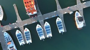 Drone video of boats and yachts docked in harbour birds eye gallery image