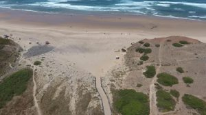 drone flying over secret surf beach gallery image