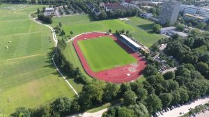Aerial drone view of running track stadium 1