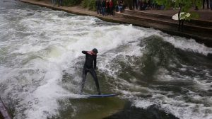 man surfing in Munichbotanic garden image