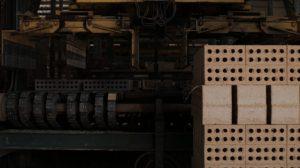 Brick manufacturing machine moving new bricks img