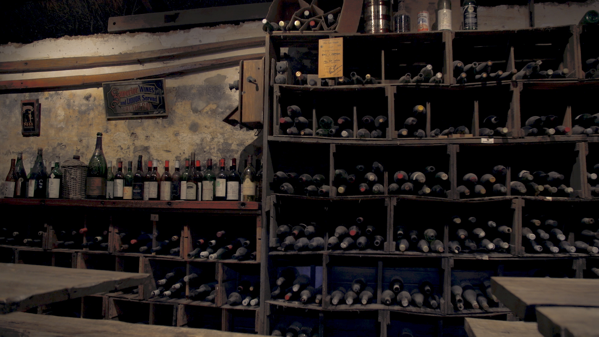 Old wine cellar full of vintage bottles of wine
