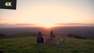 royalty free stock video 4K Sunset picnic on hill overlooking City Adelaide 1
