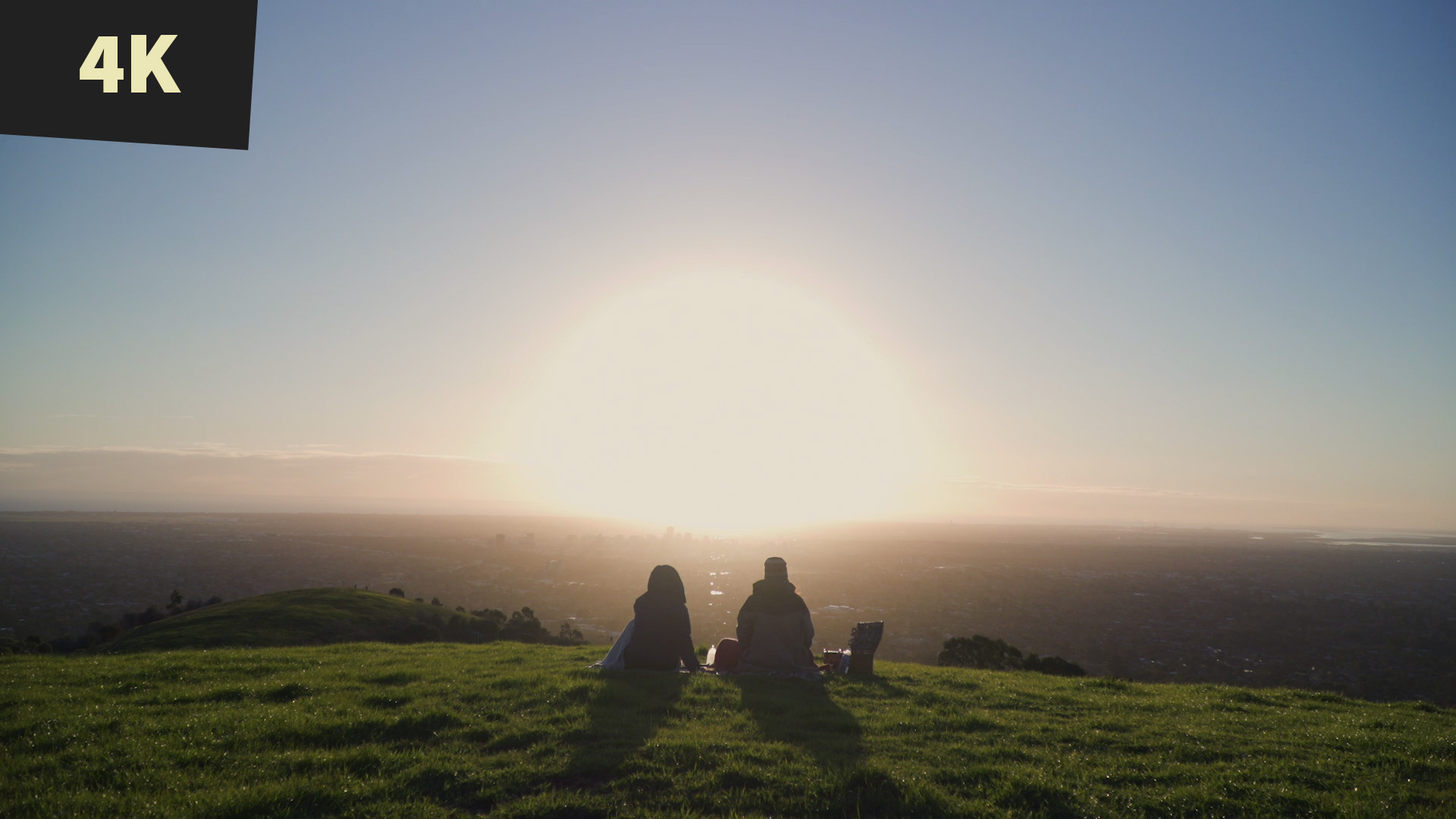 royalty free stock video 4K Sunset picnic on hill overlooking City Adelaide 3