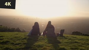 royalty free stock video 4K Sunset picnic on hill overlooking City Adelaide 4