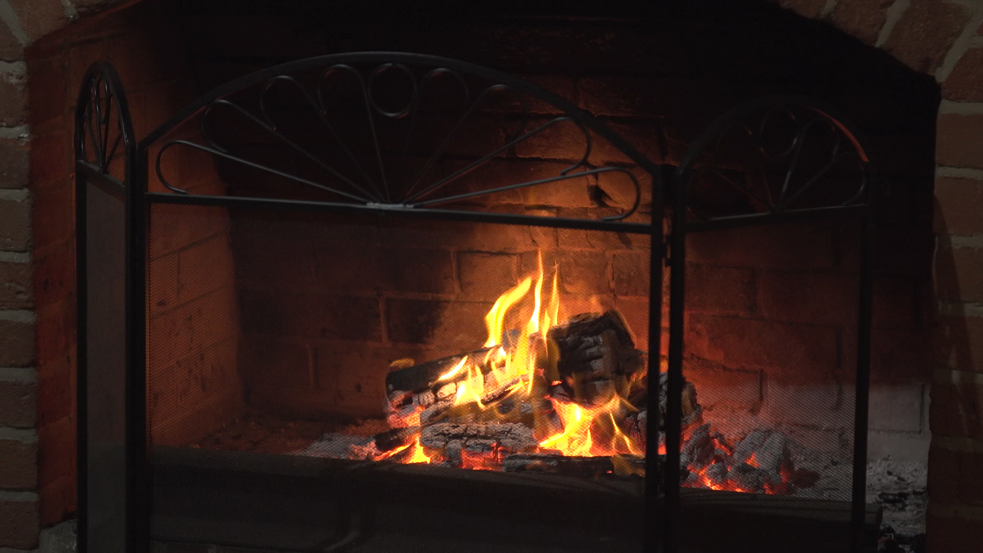 Warm slow motion fireplace buring during winter